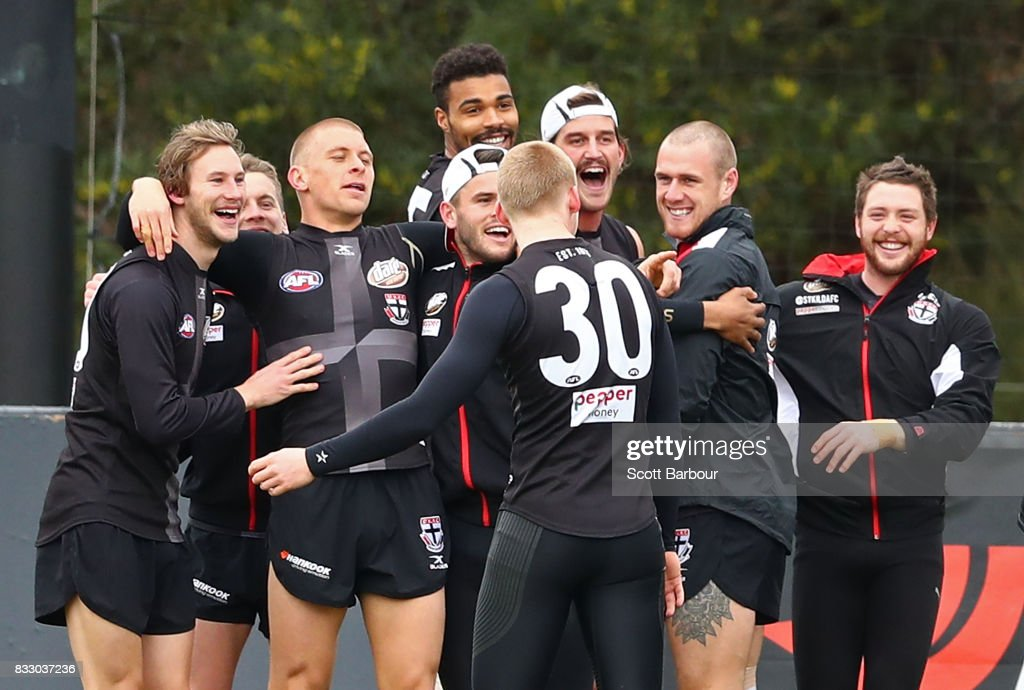 Jimmy Webster (L) of the Saints, Jack Steven of the Saints (R) and their teammates embrace during a training exercise during a St Kilda Saints AFL training session at Linen House Oval on August 17, 2017 in Melbourne, Australia.