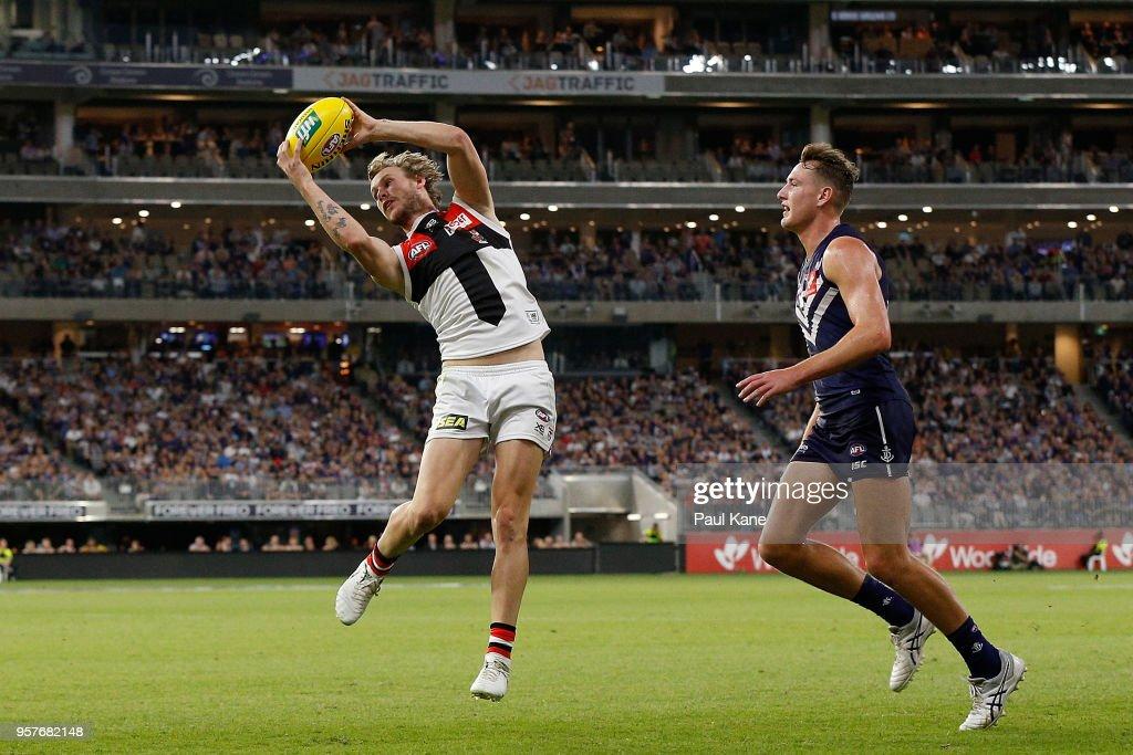 Jimmy Webster of the Saints marks the ball during the round eight AFL match between the Fremantle Dockers and the St Kilda Saints at Optus Stadium on May 12, 2018 in Perth, Australia.