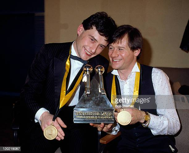 Jimmy White of England and Alex Higgins of Northern Ireland winners of the World Snooker Doubles Championship at the Derngate in Northampton 16th...