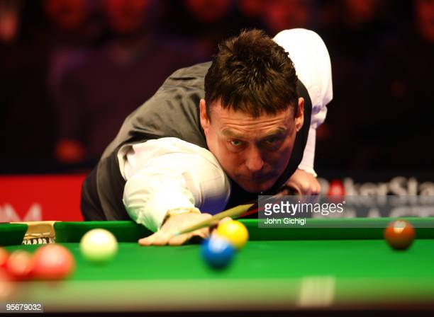Jimmy White of England lines up a shot during his game against Mark King of England in the PokerStarscom Masters Snooker tournament at Wembley Arena...