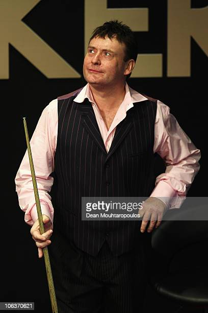 Jimmy White of England looks on during his match against Ding Junhui of China at the inaugural Power Snooker Tournament held at The O2 Arena on...