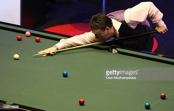 Jimmy White of England plays a shot during his match against Ding Junhui of China at the inaugural Power Snooker Tournament held at The O2 Arena on...