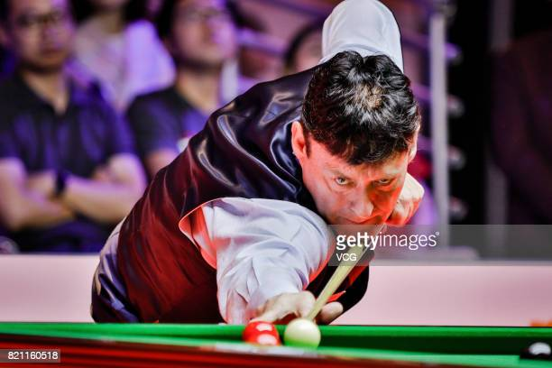 Jimmy White of England plays a shot during the third exhibition game against Stephen Hendry of Scotland on day four of 2017 Hong Kong Masters at...