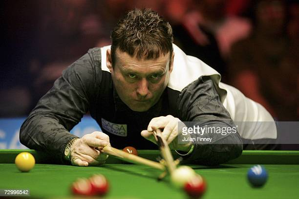 Jimmy White of England plays a shot in his match against Matthew Stevens of Wales during the 2007 Saga Insurance Masters Snooker Qualifying at...