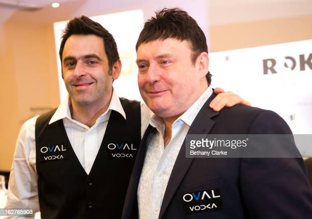Jimmy White poses with Ronnie O'Sullivan speaks during a press conference at Hilton London Metropole on February 26 2013 in London England Reigning...
