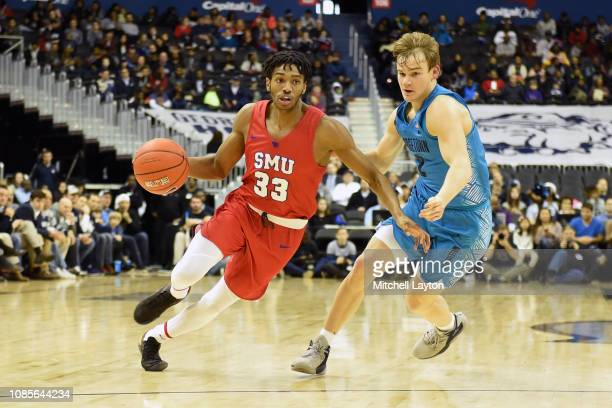 Jimmy Whitt Jr #33 of the Southern Methodist Mustangs dribbles around Mac McClung of the Georgetown Hoyas during a college basketball game at the...