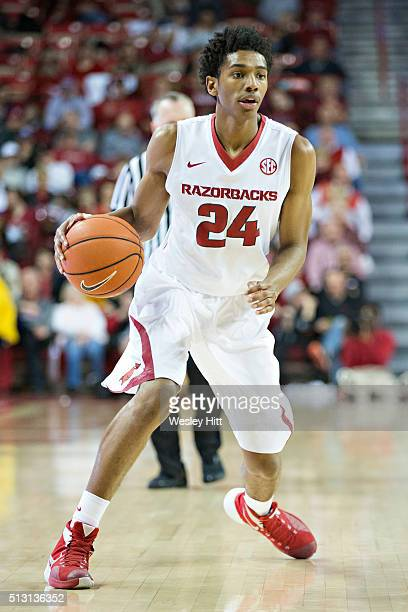 Jimmy Whitt of the Arkansas Razorbacks dribbles the ball and looks to make a pass against the LSU Tigers at Bud Walton Arena on February 23 2016 in...