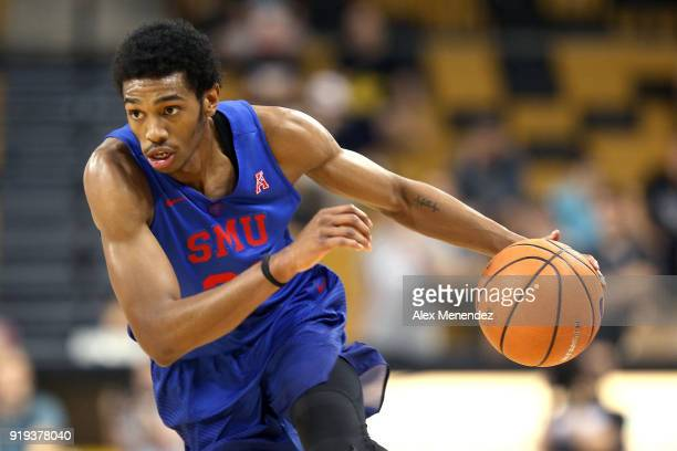 Jimmy Whitt of the Southern Methodist Mustangs dribbles the ball up the court during a NCAA basketball game against the UCF Knights at the CFE Arena...