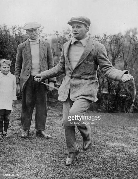Jimmy Wilde jumps rope as he trains for his upcoming fight against Pancho Villa as his trainer Benny Williams watches on May1923 in New YorkNew York
