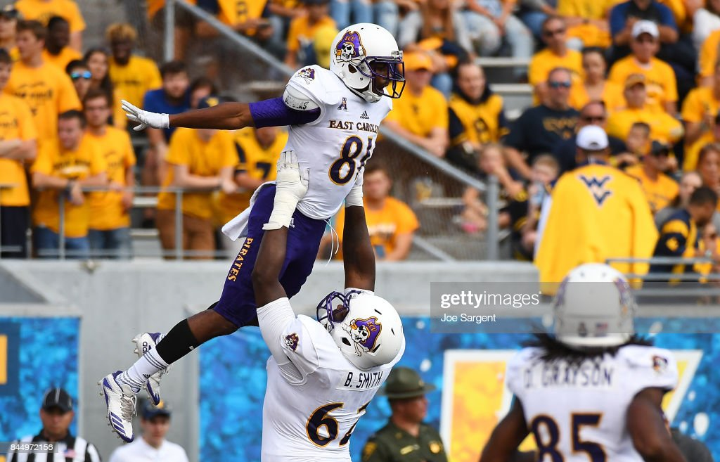 Jimmy Williams #81 celebrates his touchdown with Brandon Smith #62 of the East Carolina Pirates during the third quarter against the West Virginia Mountaineers at Mountaineer Field on September 9, 2017 in Morgantown, West Virginia.