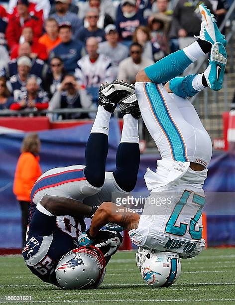 Jimmy Wilson of the Miami Dolphins stops the run of LeGarrette Blount of the New England Patriots in the first quarter at Gillette Stadium on October...