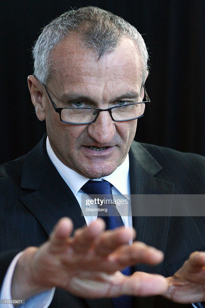 Jimmy Wilson, president of iron ore at BHP Billiton Ltd., gestures as he speaks at a launch event for the company's new Integrated Remote Operations Centre in Perth, Australia, on Tuesday, July 2, 2013. BHP Billiton is the world's largest mining company. Photographer: Sergio Dionisio/Bloomberg via Getty Images