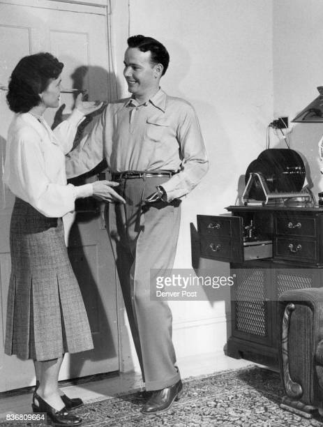 Jimmy Wilson quadruple amputee of World War II gets a rhumba lesson from his pretty wife Dorothy in their Boulder Colo home Credit The Denver Post