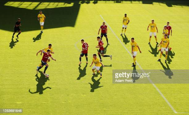 JimPatrick Mueller of FC Carl Zeiss Jena attacks with the ball during the 3 Liga match between SpVgg Unterhaching and FC Carl Zeiss Jena at...