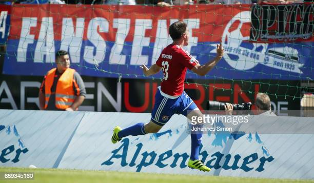 JimPatrick Mueller of Unterhaching celebrates after scoring his team's first goal during the third league playoff leg one match at Alenbauer...