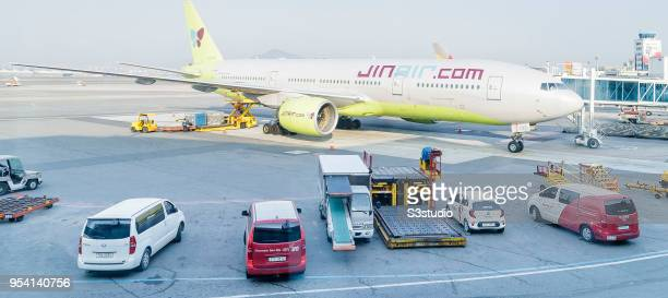 Jin Air Boeing 777 sits on the tarmac at the a Gimpo International Airport gate on 17 April 2018 in Seoul South Korea Korea's budget carriers are now...