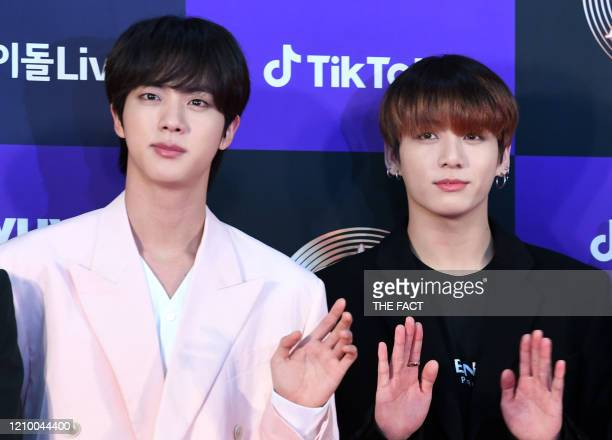 Jin and Jungkook of BTS arrives at the photo call for the 34th Golden Disc Awards on January 05 2020 in Seoul South Korea