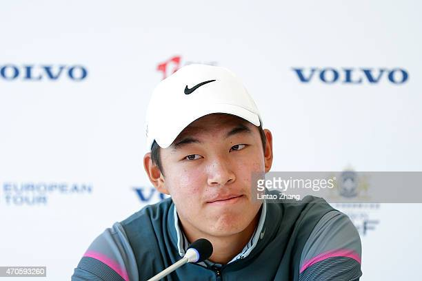 Jin Cheng of China speaks to the media during a news conference during the proam prior to the start of the Volvo China Open at Tomson Shanghai Pudong...