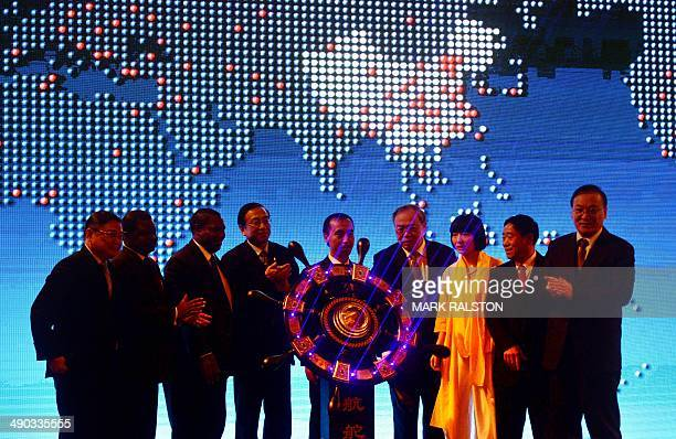 Jin Chenglong who is the chairman of the new Elephant Alliance Global Economy and Trade Platform stands with diplomats and businessmen at the launch...