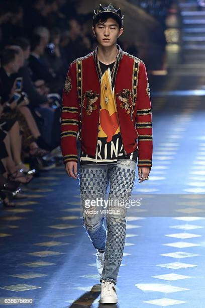Jin Dachuan walks the runway at the Dolce Gabbana show during Milan Men's Fashion Week Fall/Winter 2017/18 on January 14 2017 in Milan Italy