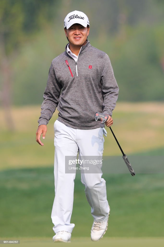 Jin Daxing reacts after the plays a shot during the first round of the 2018 Volvo China Open at Topwin Golf and Country Club on April 26, 2018 in Beijing, China.