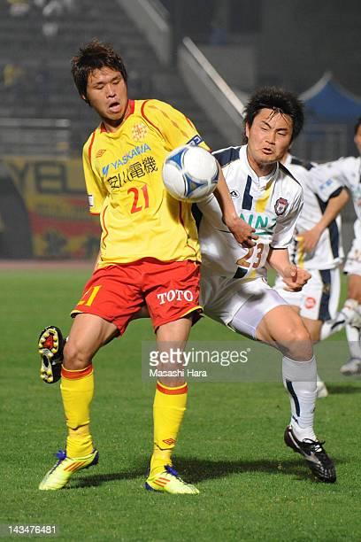 Jin Hanato of Giravanz Kitakyushu and Tatsushi Koyanagi of Thespa Kusatsu compete for the ball during the JLeague Second Division match between...