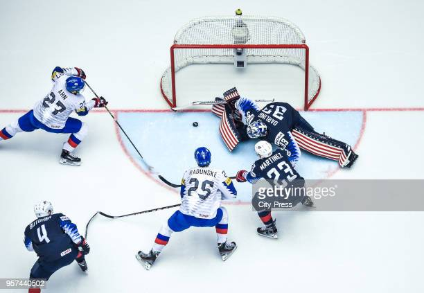 Jin Hui Ahn of Team Korea, Will Butcher of Team USA, Brock Radunske of Team Korea, Alec Martinez and Scott Darling of Team USA during the IIHF World...