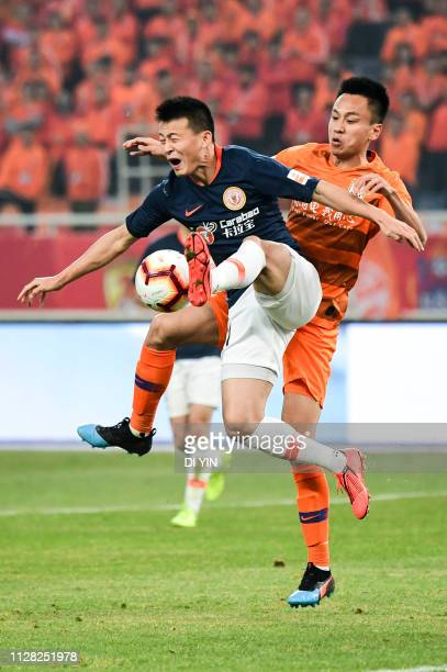 Jin Hui of Beijing Renhe gets away from challenge during the 2019 Chinese Super League match between Shandong Luneng and Beijing Renhe at Luneng...