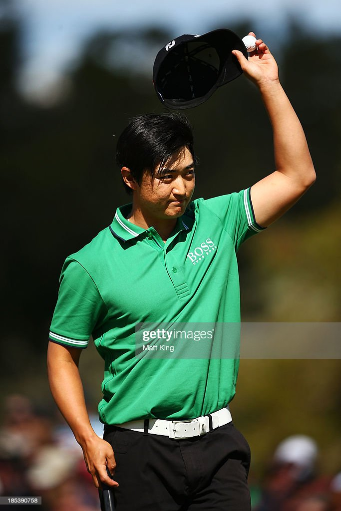 Jin Jeong of Korea acknowledges the crowd after putting on the 18th hole and forcing a playoff against Ross Fisher of England during day four of the Perth International at on October 20, 2013 in Perth, Australia.