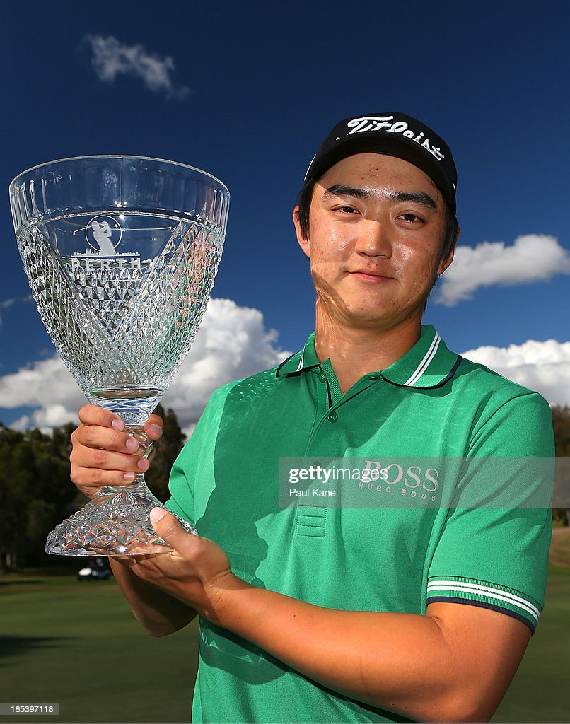 Jin Jeong of Korea holds aloft the winners trophy after defeating Ross Fisher of England on a play-off hole to win the tournament during day four of the Perth International at Lake Karrinyup Country Club on October 20, 2013 in Perth, Australia.