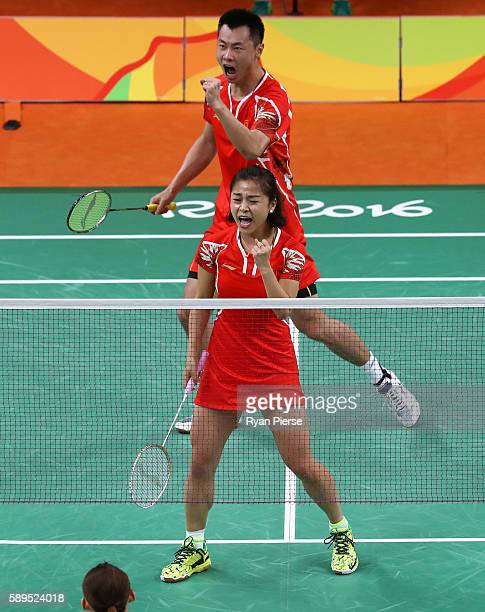 Jin Ma and Chen Xu of China celebrate during their Mixed Doubles Quarter Final match against Korea during on Day 9 of the Rio 2016 Olympic Games at...