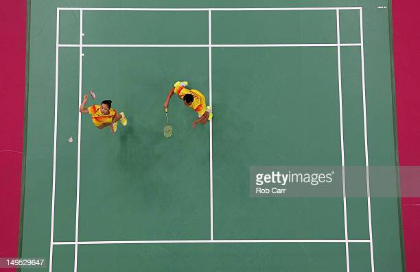 Jin Ma and Chen Xu of China compete during their Mixed Doubles Badminton match against Sudket Prapakamol and Saralee Thoungthongkam of Thailand on...