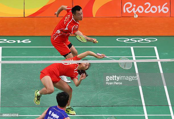 Jin Ma and Chen Xu of China in action during their Mixed Doubles Quarter Final match against Korea during on Day 9 of the Rio 2016 Olympic Games at...