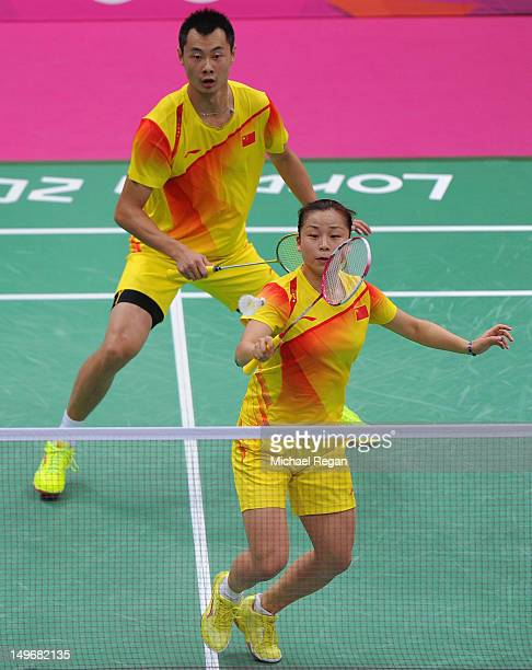 Jin Ma and Chen Xu of China return against Tontowi Ahmad and Lilyana Natsir of of Indonesia in their Mixed Doubles Badminton semi final on day 6 of...