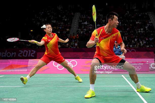 Jin Ma lunges for a shot as she and Chen Xu of China compete in the Mixed Doubles Badminton Gold Medal match against compatriots Nan Zhang and Yunlei...