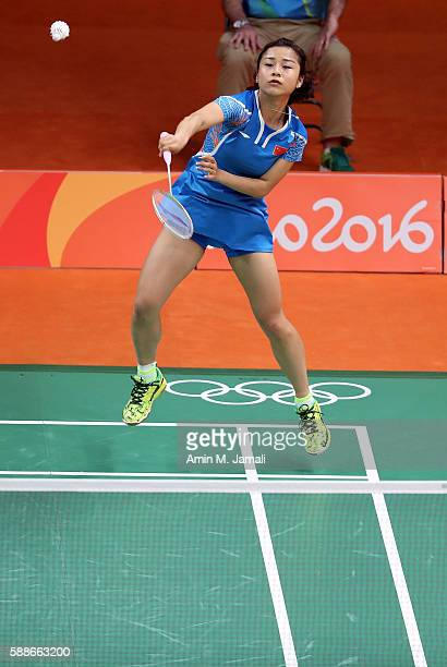 Jin Ma of China of China competes against Nadiezda Zieba and Robert Mateusiak of Poland in the badminton Mixed Double on Day 7 of the 2016 Rio...
