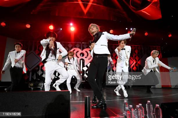 Jin V Suga Jimin Jungkook JHope and RM of BTS perform onstage during 1027 KIIS FM's Jingle Ball 2019 Presented by Capital One at the Forum on...
