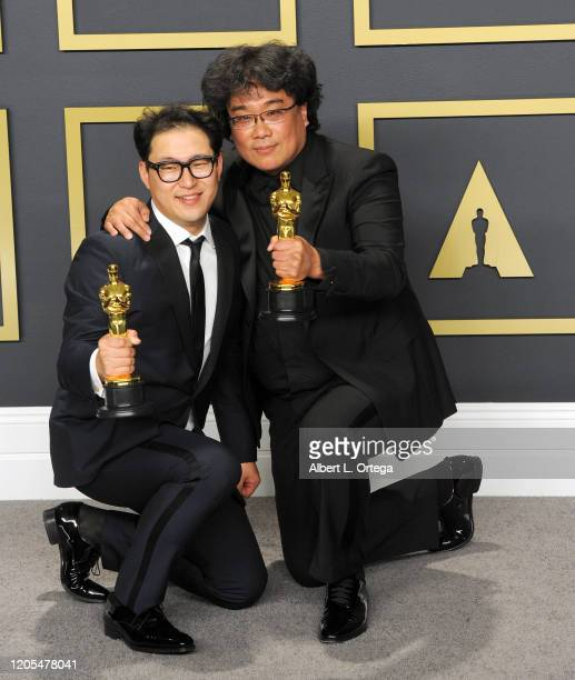 Jin Won Han and Bong Joon Ho pose with Their Awards for Original Screenplay inside The Press Room of the 92nd Annual Academy Awards held at Hollywood...