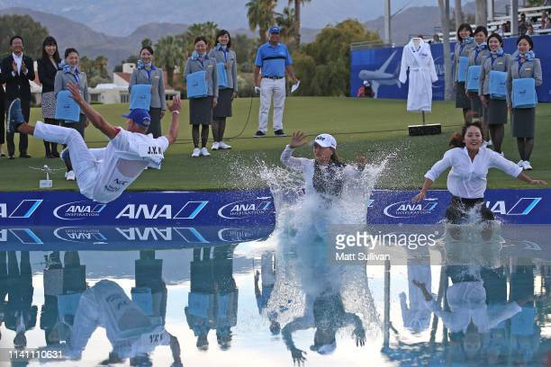 Jin Young Ko jumps into Poppies Pond with her caddie David Brooker and agent Soo Jin Choi after winning the ANA Inspiration on the Dinah Shore course...
