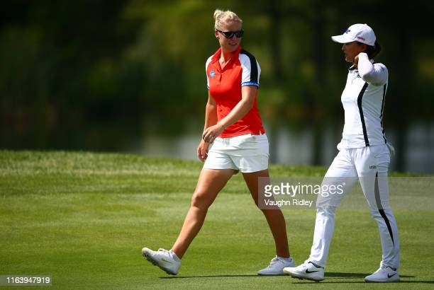 Jin Young Ko of Korea and Nicole Broch Larsen of Denmark talk while walking down the 5th fairway during the final round of the CP Women's Open at...