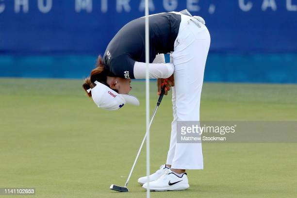 Jin Young Ko of Korea celebrates after holing out on the 18th green for the win during the final round of the ANA Inspiration on the Dinah Shore...