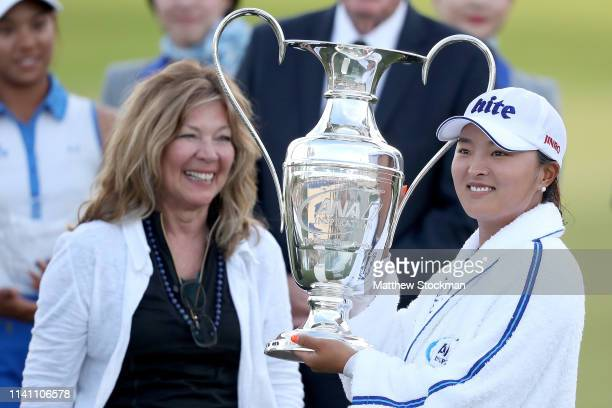 Jin Young Ko of Korea celebrates with the Dinah Shore Trophy after winning the ANA Inspiration on the Dinah Shore course at Mission Hills Country...