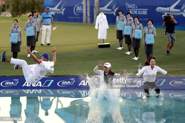 Jin Young Ko of Korea, her caddie David Brooker, and her agent Soo jin Choi, leap into Poppie's Pond next to the 18th green after her win during of...