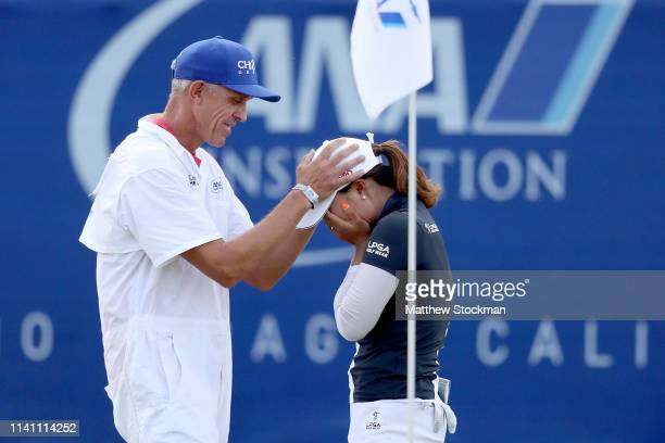 Jin Young Ko of Korea is congratulated by her caddie David Brooker after holing out to win the ANA Inspiration on the Dinah Shore course at Mission...