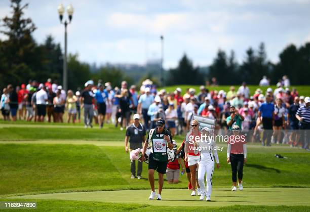 Jin Young Ko of Korea Nicole Broch Larsen of Denmark and Brooke Henderson of Canada walk down the 4th fairway during the final round of the CP...