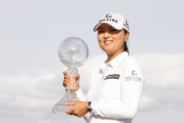 Jin Young Ko of Korea poses with the CME Globe trophy after winning the CME Group Tour Championship at Tiburon Golf Club on December 20, 2020 in...