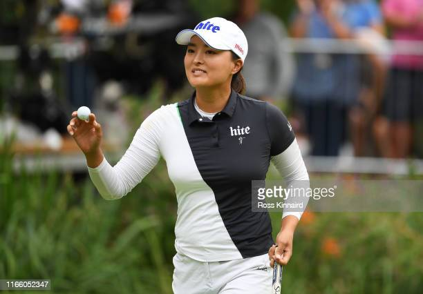 Jin Young Ko of Korea Republic acknowledges the crowd after a birdie on the 12th green during Day Four of the AIG Women's British Open at Woburn Golf...