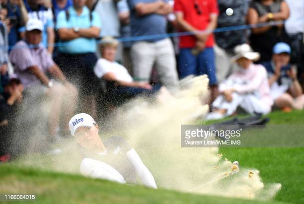 Jin Young Ko of Korea Republic plays a shot from a bunker on the 17th hole during Day Four of the AIG Women's British Open at Woburn Golf Club on...