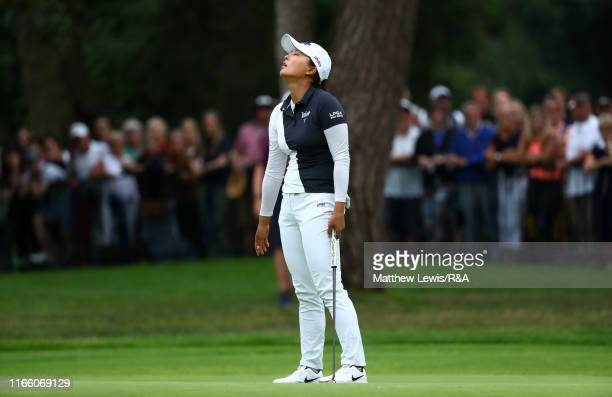 Jin Young Ko of Korea Republic reacts after a missed putt on the 18th green during Day Four of the AIG Women's British Open at Woburn Golf Club on...