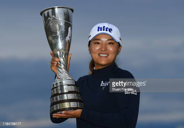 Jin Young Ko of South Korea celebrates with the trophy following victory in the Evian Championship at Evian Resort Golf Club on July 28 2019 in...